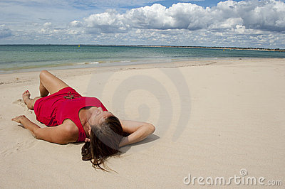 Woman in Red Dress on the Beach