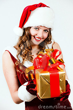 Woman in a red dress of Santa with a big gift