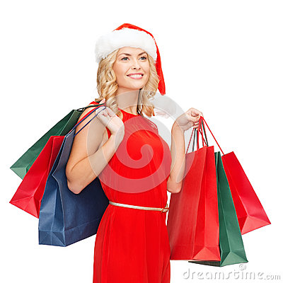 Woman in red dress with shopping bags