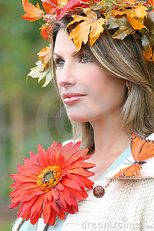 Woman with red flower, fall leaves, and butterfly