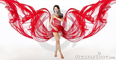 Woman in red flying waving dress as wings