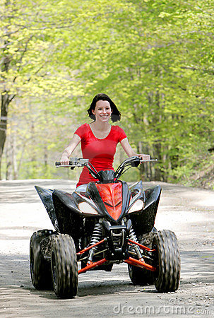 Woman in red on four wheeler