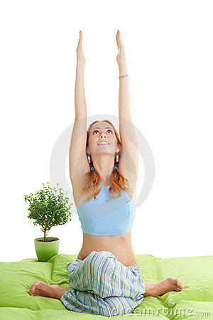 Woman with red hair do yoga exercises
