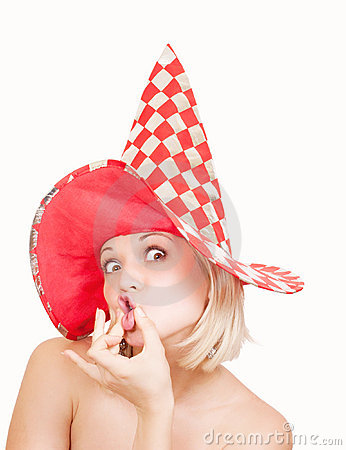 Woman in red hat making a funny face on white