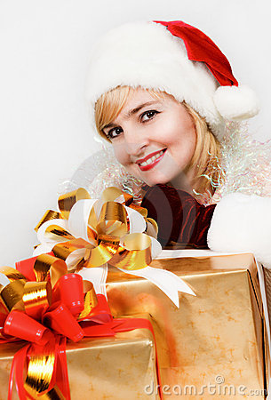 Woman in a red hat of Santa with a big gift