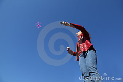 Woman in red jacket playing with propeller