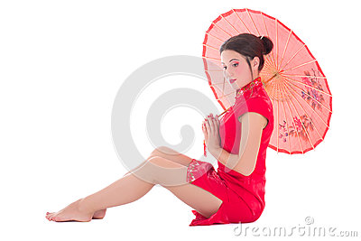 Woman in red japanese dress with umbrella isolated on white