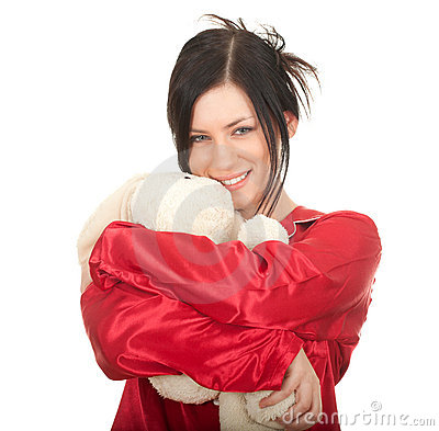 Woman in red pajamas with teddy bear