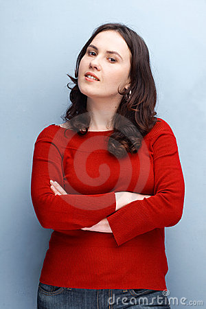 Woman in Red Posing With Hands Folded