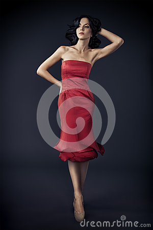 Woman In Red Rose Dress On Dark