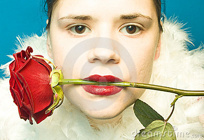Woman with red rose in mouth