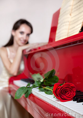 Woman and Red rose on red piano