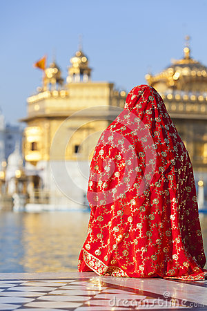 Woman in red sari at Golden Temple.