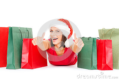 Woman in red shirt with shopping bags