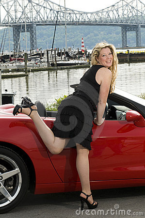 Woman red sports car