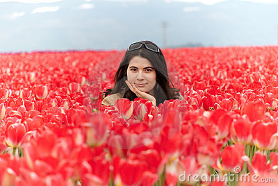Woman in red tulips field