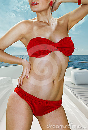 Woman in red underwear on yacht