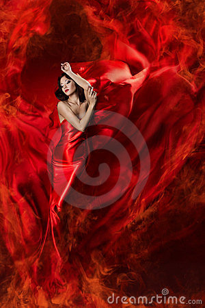 Woman in red waving dress as fire flame