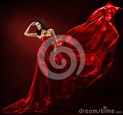 Woman in red waving dress with flying fabric