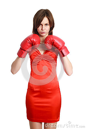 Woman in red, wearing boxing gloves