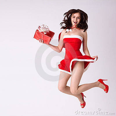 Woman in red xmas costume fly with gift