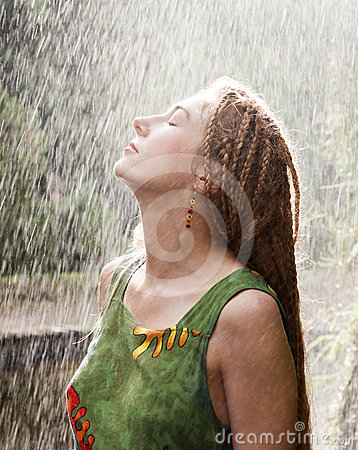 Woman refreshing in the rain