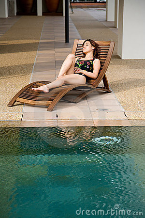 Woman relax by the pool side