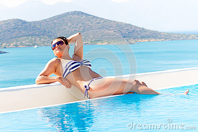 Woman at relaxation near swimming pool
