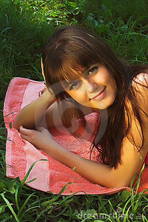 Free Woman Relaxes On The Grass Royalty Free Stock Photos - 5544598