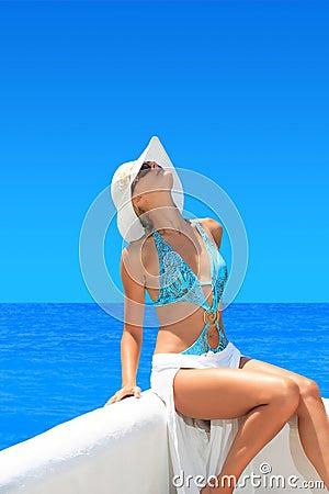 Woman relaxing on beautiful shoreline