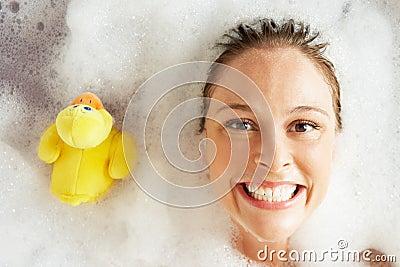 Woman Relaxing In Bubble Filled Bath