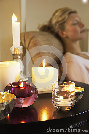 Free Woman Relaxing By Table With Lit Candles Stock Photography - 31831122