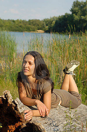 Woman relaxing in countryside