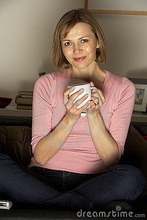 Woman Relaxing With Cup Of Coffee