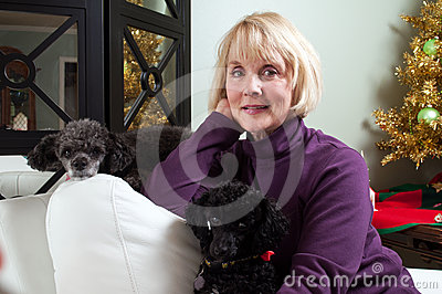 Woman relaxing with dogs