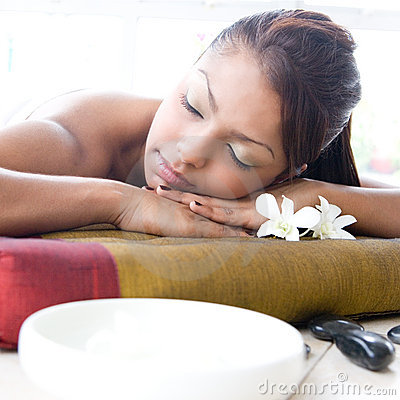 Woman relaxing and enjoying a day at spa
