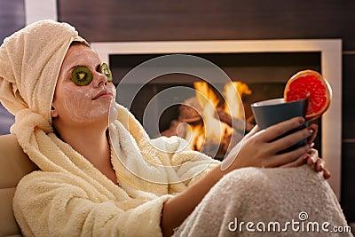 Woman relaxing in facial mask