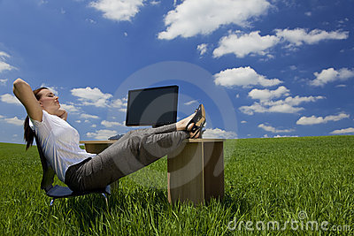 Woman Relaxing In a Green Office