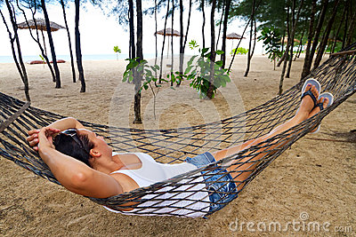 Woman relaxing on the hammock