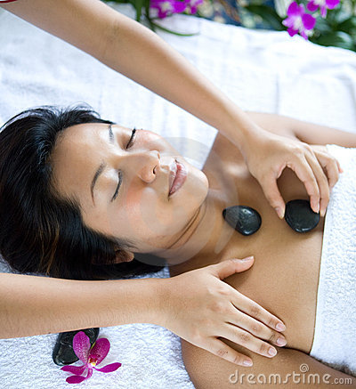 Woman relaxing while having spa treatment