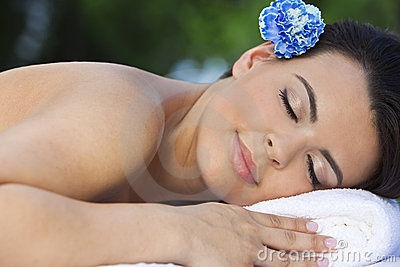 Woman Relaxing At Health Spa With Blue Flower