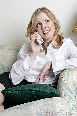 Woman relaxing at home talking on the phone