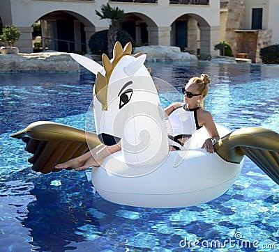 Free Woman Relaxing In Luxury Swimming Pool Resort Hotel With Huge Bi Royalty Free Stock Image - 87032946