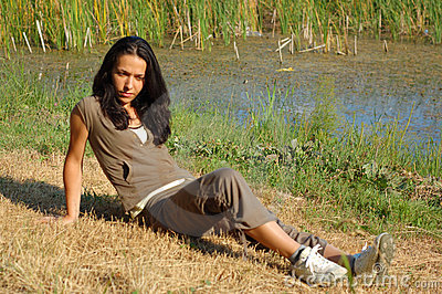 Woman relaxing by lake