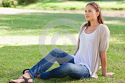 Woman relaxing on the lawn