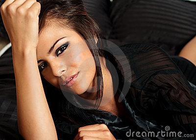 Woman relaxing while lying in bed