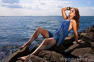 Woman relaxing by ocean