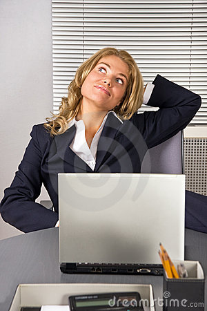 Woman relaxing in office with a laptop