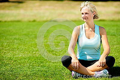 Woman relaxing outdoors, peaceful morning.