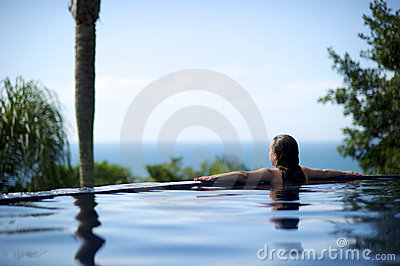 Woman relaxing in a paradise sea view